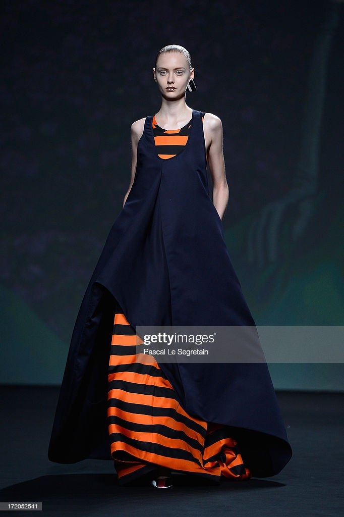 A model walks the runway during the Christian Dior show as part of Paris Fashion Week Haute-Couture Fall/Winter 2013-2014 at Hotel Des Invalides on July 1, 2013 in Paris, France.
