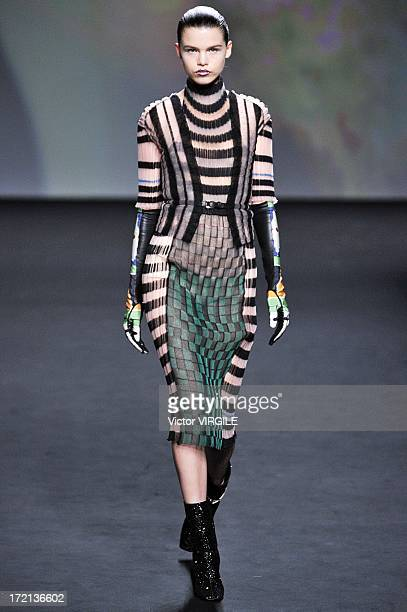 A model walks the runway during the Christian Dior show as part of Paris Fashion Week HauteCouture Fall/Winter 20132014 at Hotel Des Invalides on...