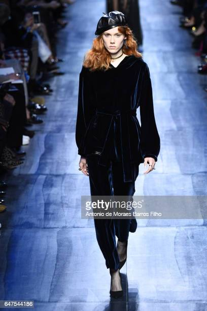 A model walks the runway during the Christian Dior show as part of the Paris Fashion Week Womenswear Fall/Winter 2017/2018 on March 3 2017 in Paris...