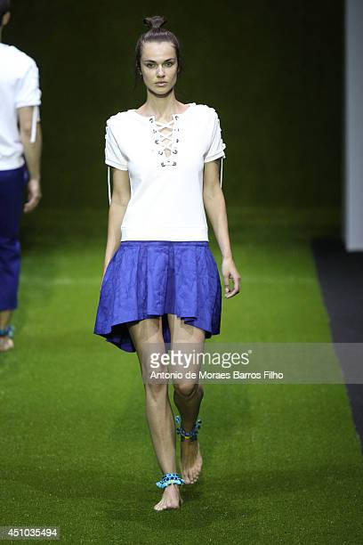 A model walks the runway during the Christian Pellizzari show as a part of Milan Fashion Week Menswear Spring/Summer 2015 on June 21 2014 in Milan...