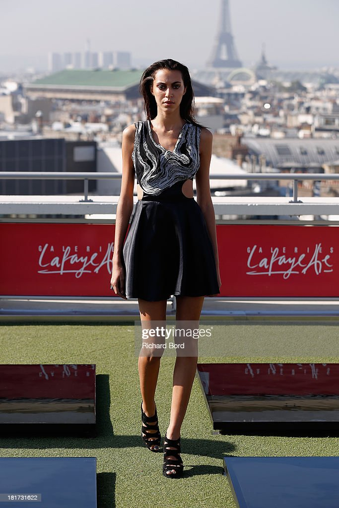 A model walks the runway during the Christine Phung show as part of the Paris Fashion Week Womenswear Spring/Summer 2014 at Galeries Lafayette on September 24, 2013 in Paris, France.