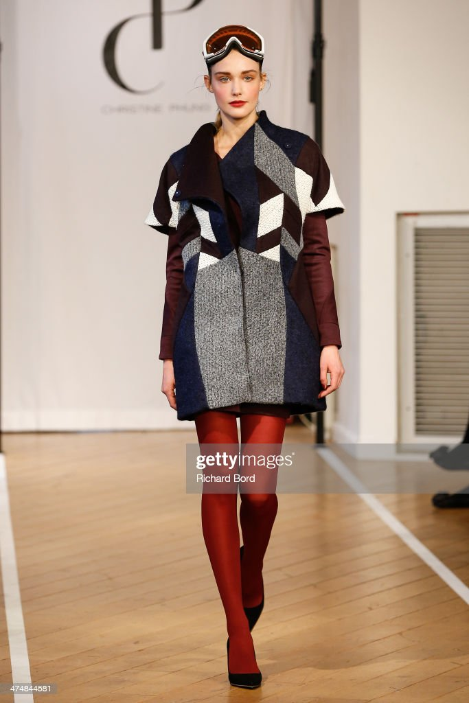 A model walks the runway during the Christine Phung show as part of the Paris Fashion Week Womenswear Fall/Winter 20142015 at Lafayette Maison on...