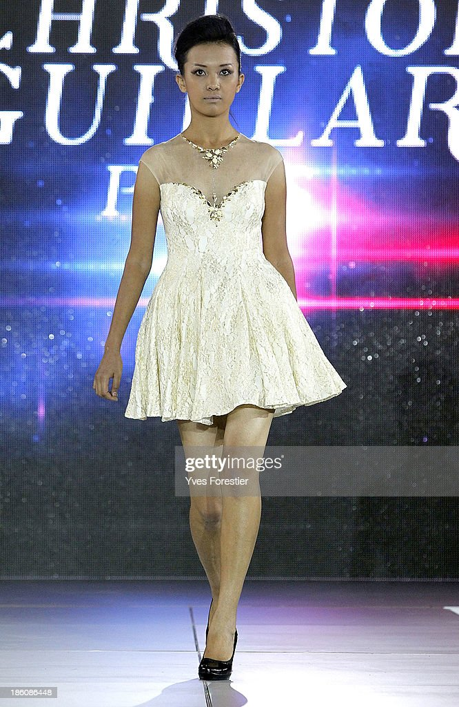 A model walks the runway during the Christophe Guillarme fashion show as part of the Art Style UZ 2013 at The Youth Art Palace on October 25, 2013 in Tashkent, Uzbekistan.