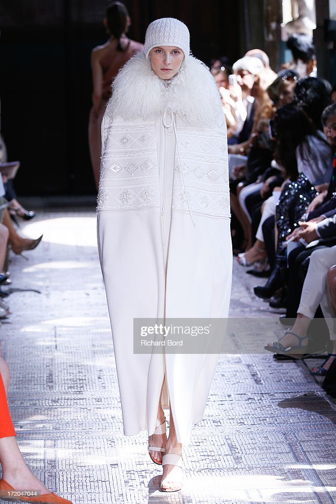 A model walks the runway during the Christophe Josse show as part of Paris Fashion Week Haute-Couture Fall/Winter 2013-2014 at les Beaux Arts on July 1, 2013 in Paris, France.