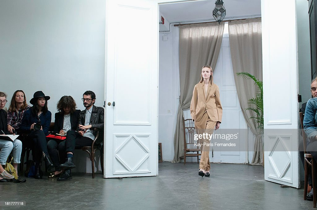A model walks the runway during the Christophe Lemaire show as part of the Paris Fashion Week Womenswear Spring/Summer 2014 on September 25, 2013 in Paris, France.