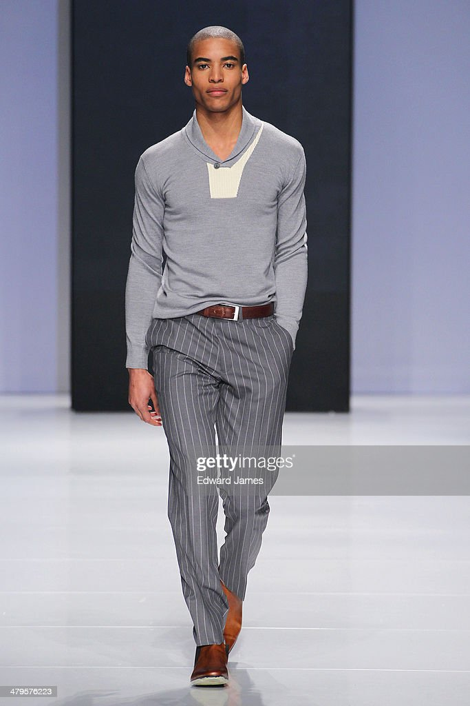 A model walks the runway during the Christopher Bates fashion show during World Mastercard fashion week on March 19, 2014 in Toronto, Canada.
