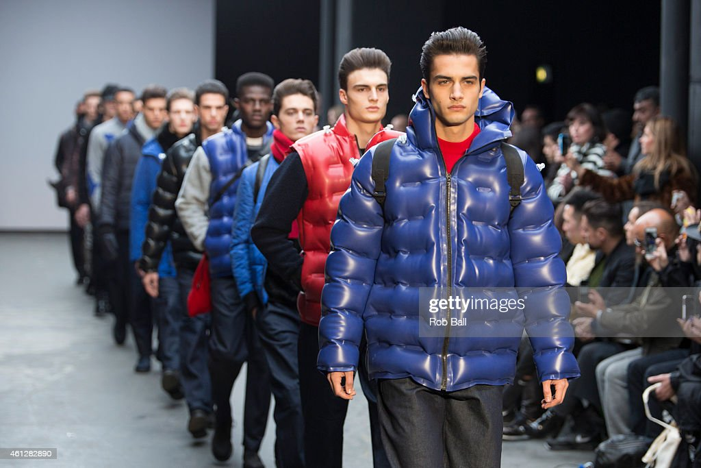 A model walks the runway during the Christopher Raeburn show at the London Collections Men AW15 at The Old Sorting Office on January 10 2015 in...