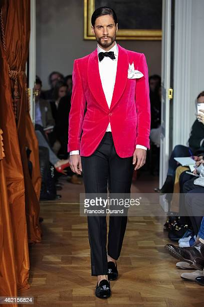A model walks the runway during the Cifonelli Menswear Fall/Winter 20152016 show as part of Paris Fashion Week on January 25 2015 in Paris France