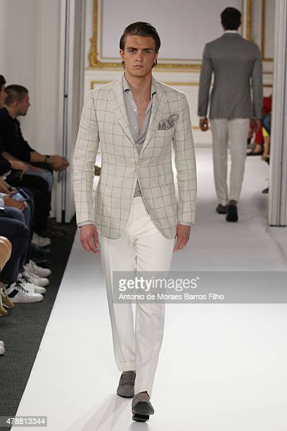 A model walks the runway during the Cifonelli Menswear Spring/Summer 2016 show as part of Paris Fashion Week on June 27 2015 in Paris France