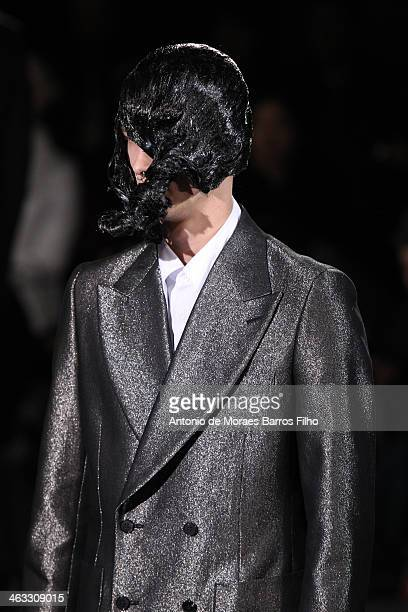 A model walks the runway during the Comme Des Garcons Menswear Fall/Winter 20142015 show as part of Paris Fashion Week on January 17 2014 in Paris...
