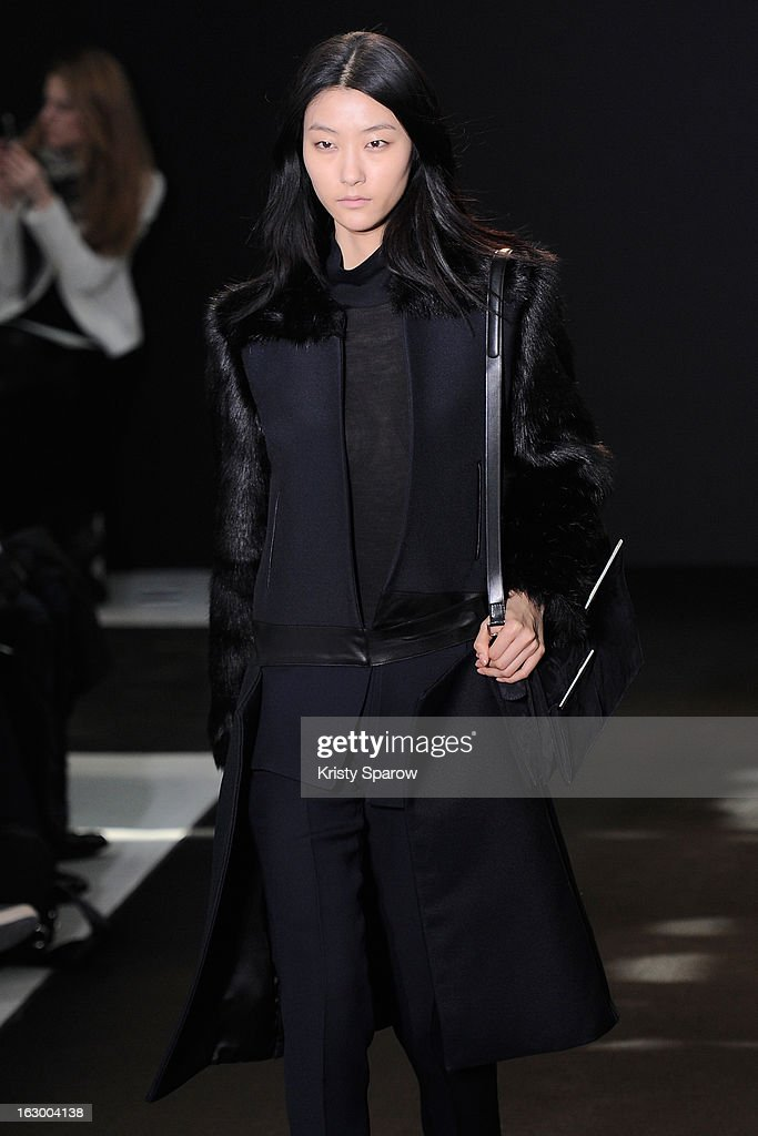 A model walks the runway during the Costume National Fall/Winter 2013/14 Ready-to-Wear show as part of Paris Fashion Week on March 3, 2013 in Paris, France.