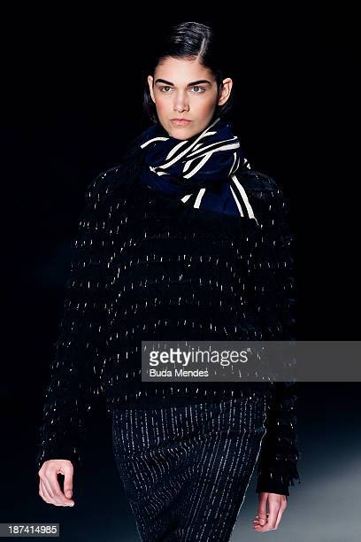 A model walks the runway during the Coven fashion show at Fashion Rio Winter 2014 at Pier Maua on November 8 2013 in Rio de Janeiro Brazil Photo by...