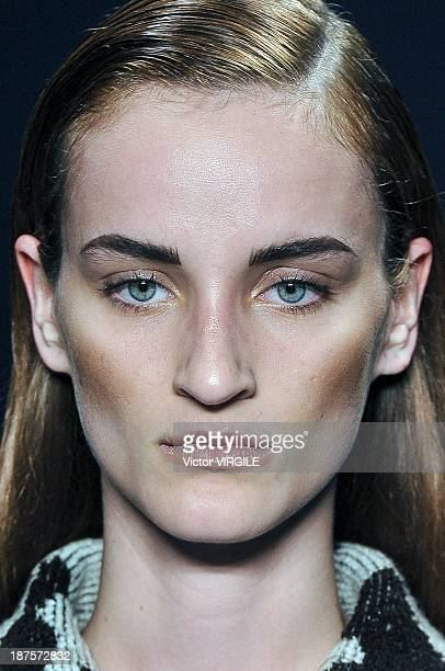 A model walks the runway during the Coven show as part of the Rio de Janeiro Fashion Week Fall/Winter 2014 on November 8 2013 in Rio de Janeiro Brazil