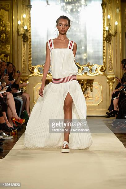 A model walks the runway during the Cristiano Burani show as part of Milan Fashion Week Womenswear Spring/Summer 2015 on September 18 2014 in Milan...