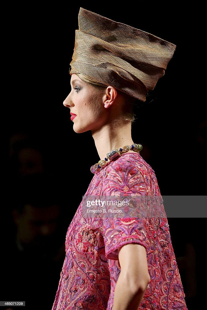 A model walks the runway during the Curiel Couture fashion show as part of AltaRoma Fashion Week Spring/Summer 2014 on January 25, 2014 in Rome, Italy.