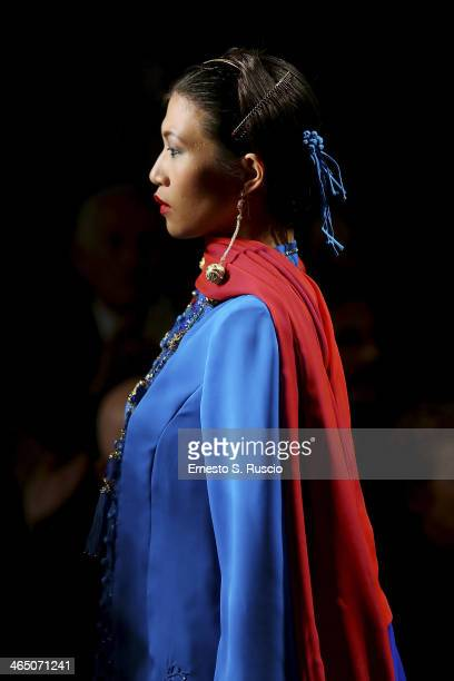 A model walks the runway during the Curiel Couture fashion show as part of AltaRoma Fashion Week Spring/Summer 2014 on January 25 2014 in Rome Italy