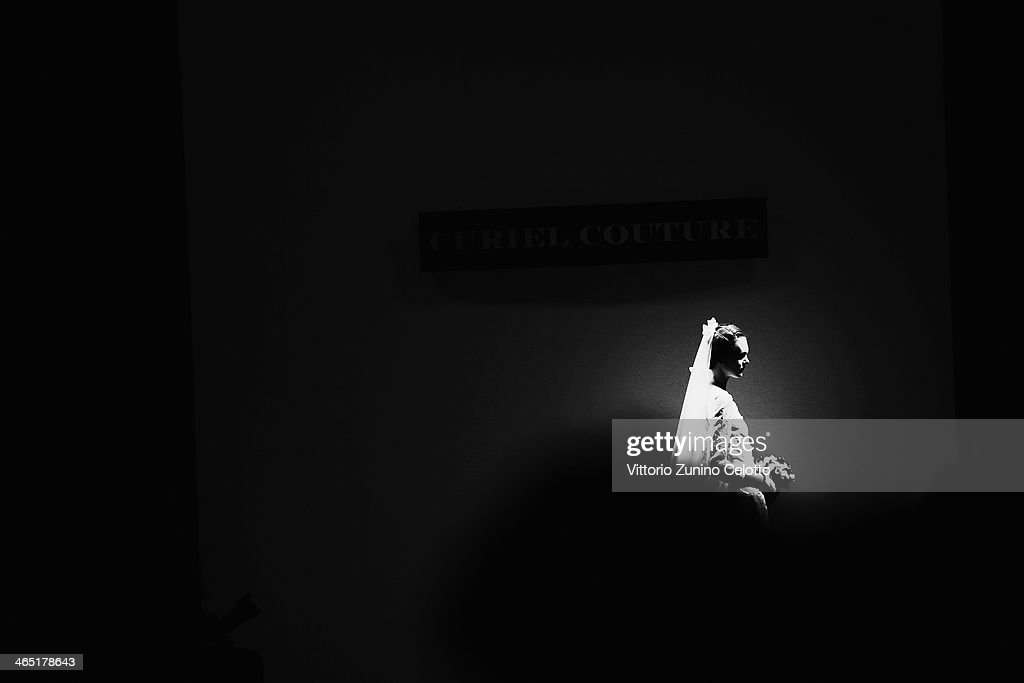 A model walks the runway during the Curiel Couture fashion show at Altaroma Altamoda on January 25, 2014 in Rome, Italy.