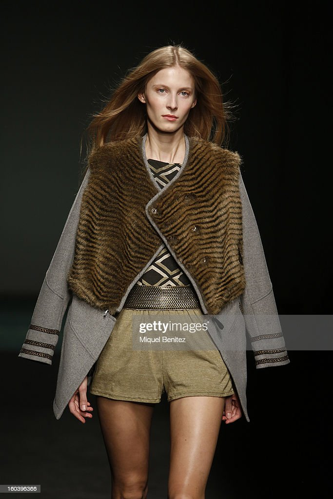 A model walks the runway during the Custo Barcelona fashion show as part of the 080 Barcelona Fashion Week Autumn/Winter 2013-2014 on January 30, 2013 in Barcelona, Spain.