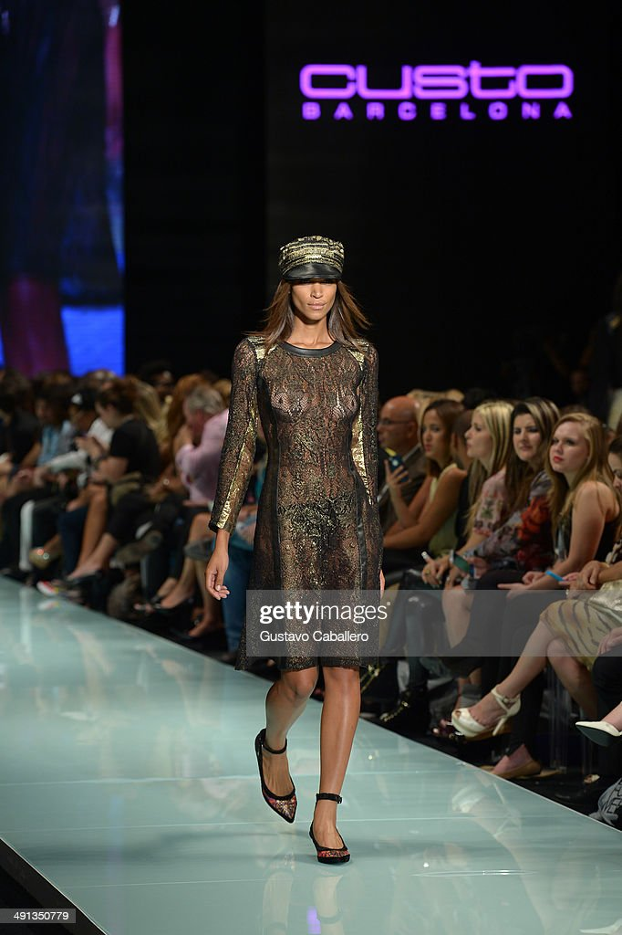 A model walks the runway during the Custo Barcelona show at the Miami Fashion Week Resort Summer 2014/2015 at Miami Beach Convention Center on May 15, 2014 in Miami,Florida.