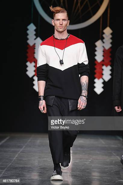 A model walks the runway during the D Gnak show as a part of Milan Menswear Fashion Week Fall Winter 2015/2016 on January 19 2015 in Milan Italy