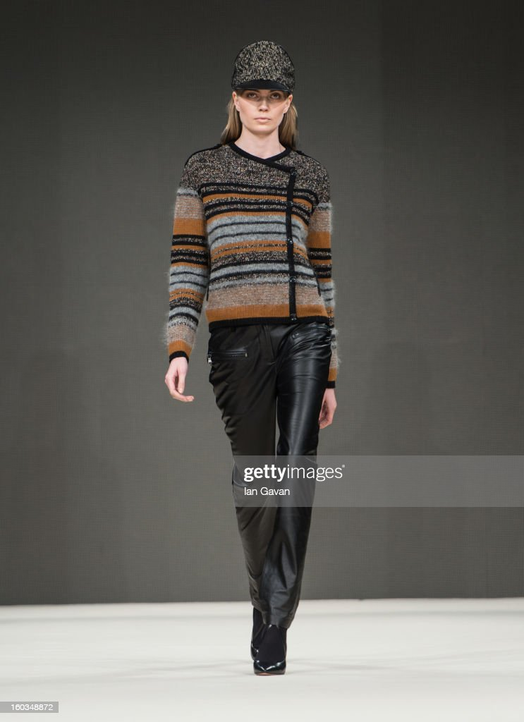 A model walks the runway during the Dagmar show at MercedesBenz Stockholm Fashion Week Autumn/Winter 2013 at MercedesBenz Fashion Pavilion on January...