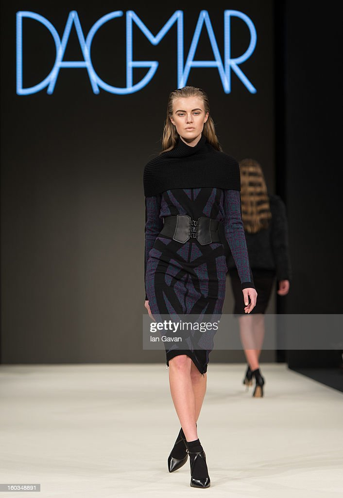 A model walks the runway during the Dagmar show at Mercedes-Benz Stockholm Fashion Week Autumn/Winter 2013 at Mercedes-Benz Fashion Pavilion on January 29, 2013 in Stockholm, Sweden.
