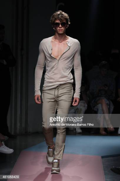 A model walks the runway during the Daks show as a part of Milan Fashion Week Menswear Spring/Summer 2015 on June 22 2014 in Milan Italy