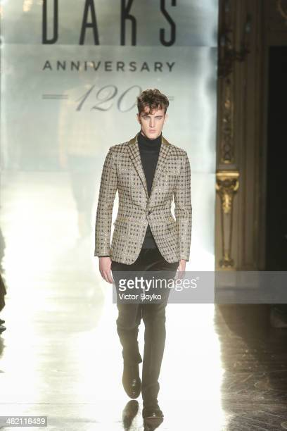 A model walks the runway during the DAKS show as a part of Milan Fashion Week Menswear Autumn/Winter 2014 on January 12 2014 in Milan Italy