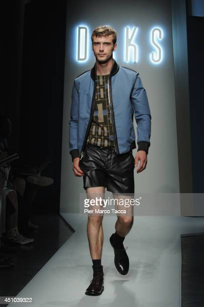 A model walks the runway during the Daks show as part of Milan Fashion Week Menswear Spring/Summer 2015 on June 22 2014 in Milan Italy
