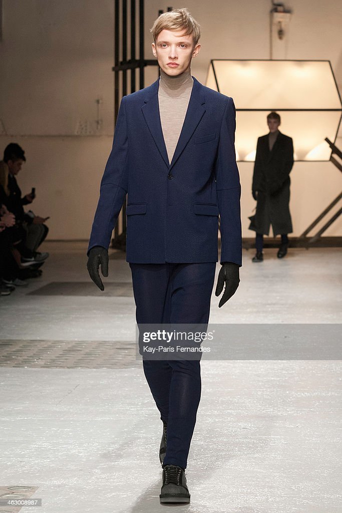 A model walks the runway during the Damir Doma Menswear Fall/Winter 2014-2015 show as part of Paris Fashion Week on January 16, 2014 in Paris, France.