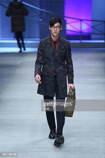 A model walks the runway during the DANCING WOLVES show as part of MercedesBenz China Fashion Week Autumn/Winter Collection at 751DPARK Workshop on...