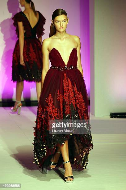 A model walks the runway during the Danny Atrache show as part of Paris Fashion Week Haute Couture Fall/Winter 2015/2016 on July 8 2015 in Paris...