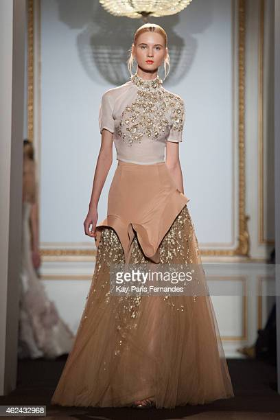 A model walks the runway during the Dany Atrache show as part of Paris Fashion Week Haute Couture Spring/Summer 2015 on January 28 2015 in Paris...