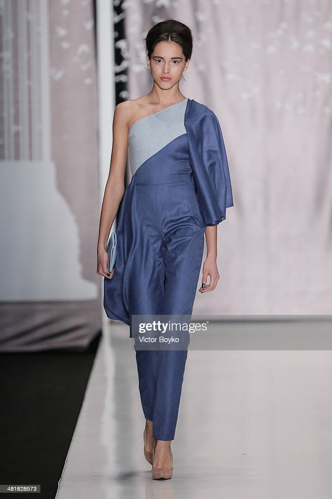 A model walks the runway during the Dasha Gauser show on day 5 of Mercedes-Benz Fashion Week Moscow AW14 on March 31, 2014 in Moscow, Russia.