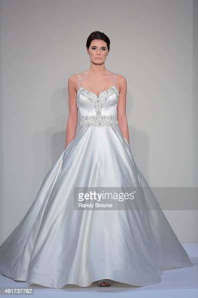 A model walks the runway during the Dennis Basso For Kleinfeld Bridal Fall/Winter 2016 Runway Show at Kleinfeld on October 7 2015 in New York City