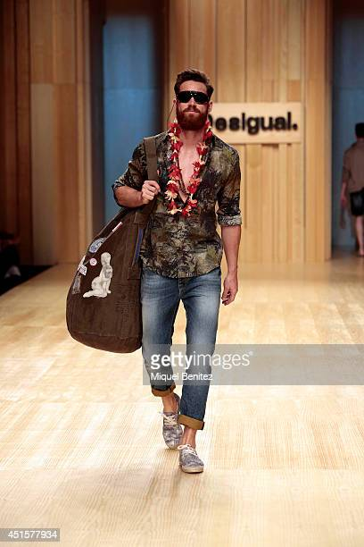 A model walks the runway during the Desigual show as part of the 080 Barcelona Fashion Spring/Summer 2015 on July 1 2014 in Barcelona Spain
