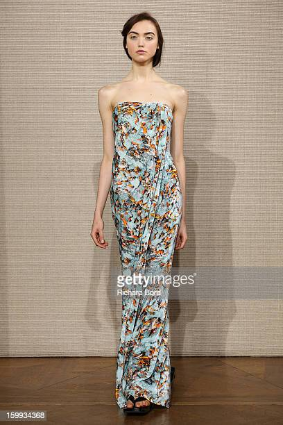 A model walks the runway during the Didit Hediprajetyo Spring/Summer 2013 HauteCouture show as part of Paris Fashion Week at ShangriLa Hotel Paris on...