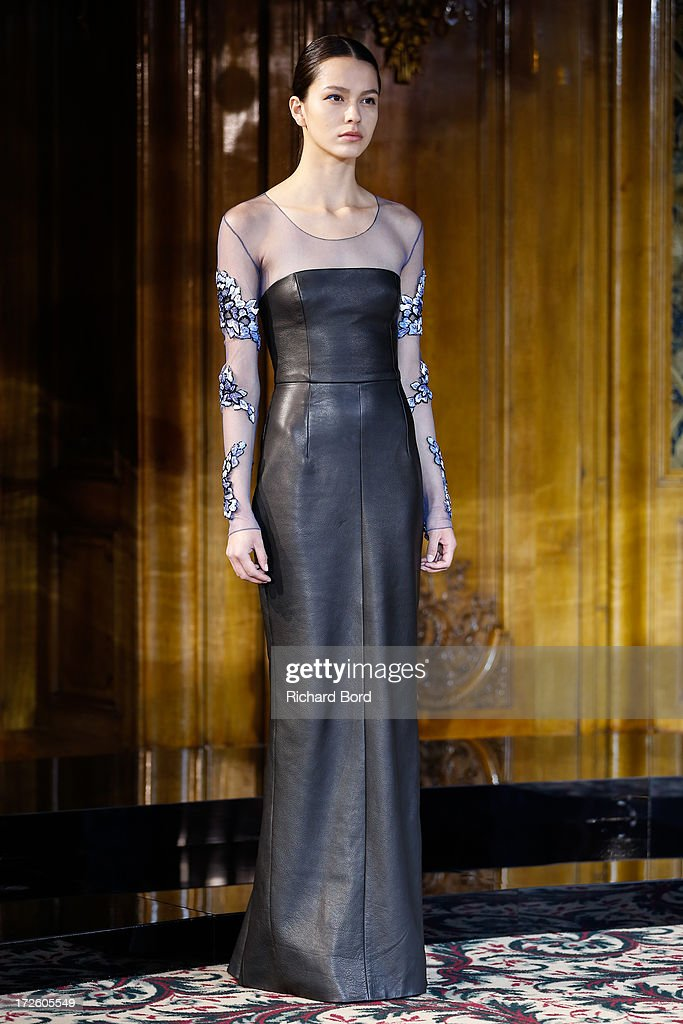 A model walks the runway during the Didit Hediprasetyo show as part of Paris Fashion Week Haute-Couture Fall/Winter 2013-2014 at Hotel Le Bristol on July 4, 2013 in Paris, France.