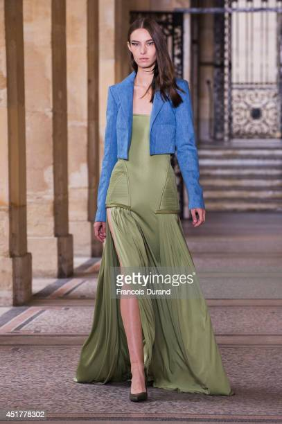 A model walks the runway during the Didit HEDIPRASETYO show as part of Paris Fashion Week Haute Couture Fall/Winter 20142015 at on July 6 2014 in...