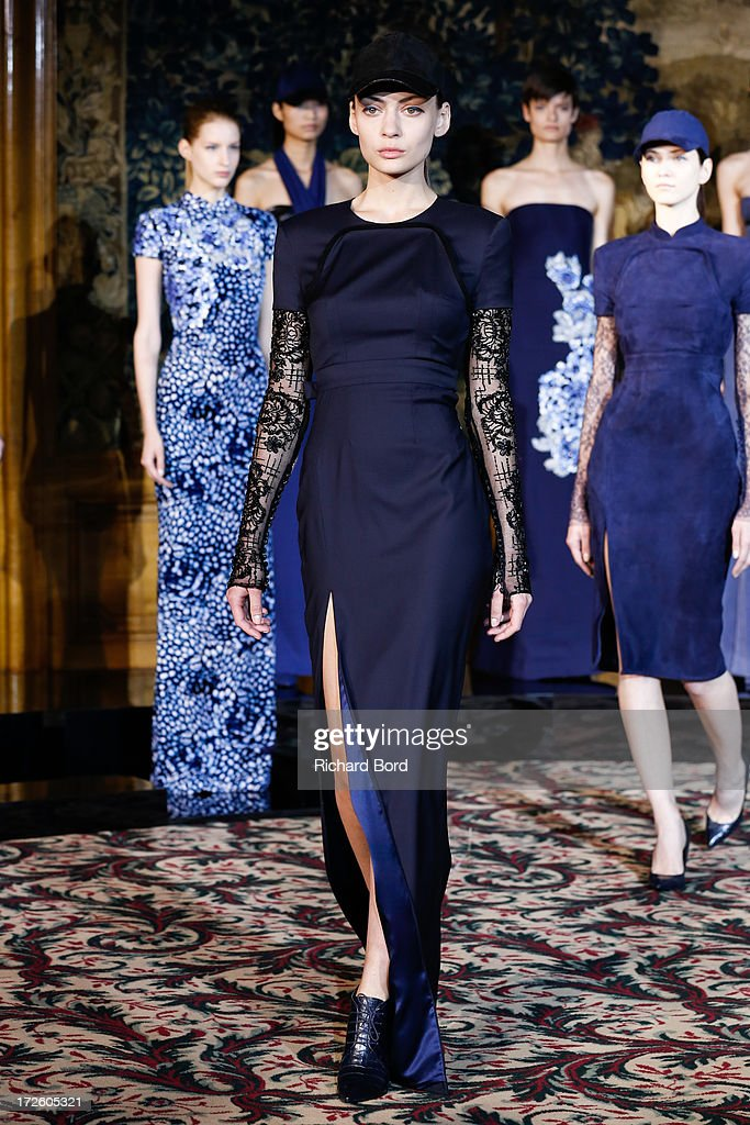 A model walks the runway during the Didit show as part of Paris Fashion Week Haute-Couture Fall/Winter 2013-2014 at Hotel Le Bristol on July 4, 2013 in Paris, France.