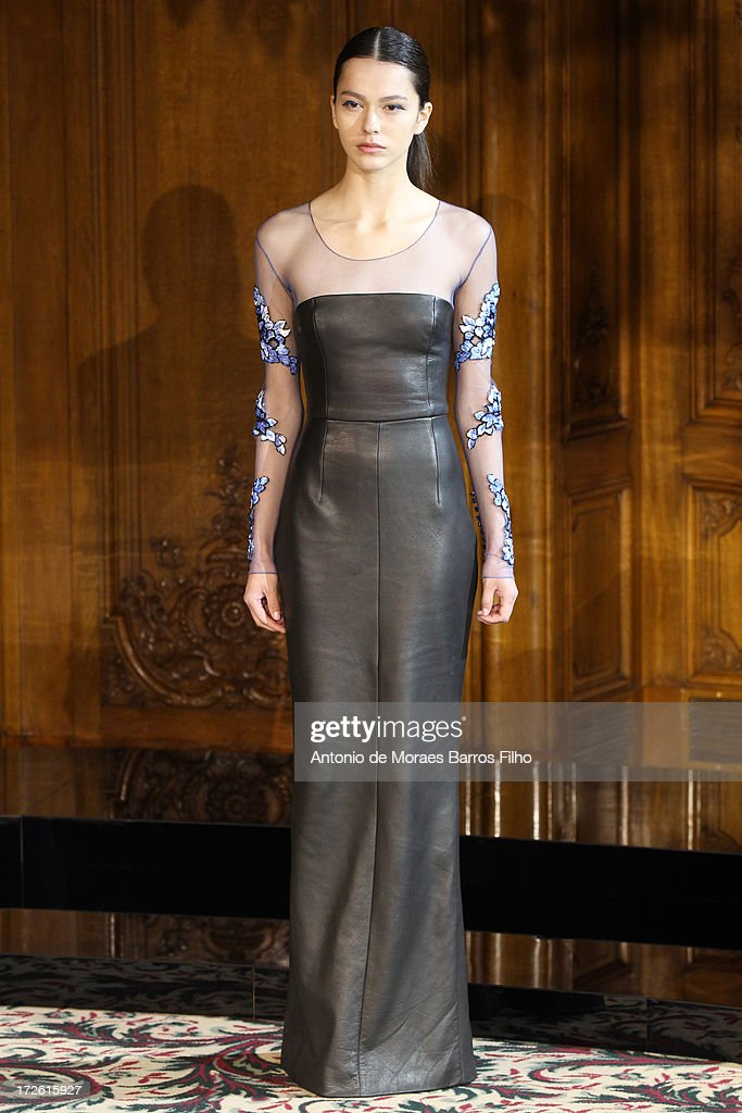 A model walks the runway during the Didit show as part of Paris Fashion Week Haute-Couture at on July 4, 2013 in Paris, France.