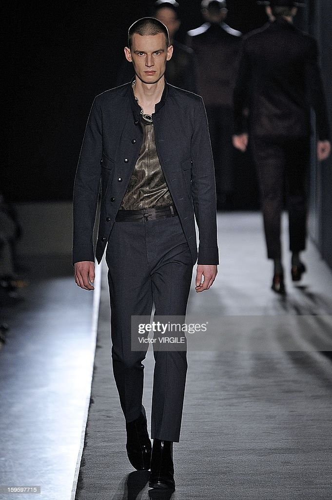A model walks the runway during the Diesel Black Gold Ready to Wear Fall/Winter 2013-2014 show as part of Milan Fashion Week Menswear Autumn/Winter 2013 on January 15, 2013 in Milan, Italy.
