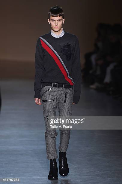 A model walks the runway during the Diesel Black Gold show as a part of Milan Menswear Fashion Week Fall Winter on January 19 2015 in Milan Italy