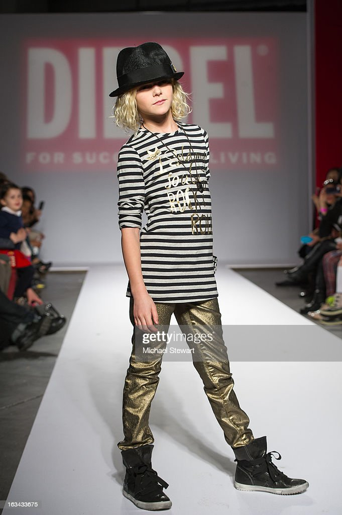 A model walks the runway during the Diesel Kids fashion show during 2013 petitePARADE Kids Fashion Week at Industria Superstudio on March 9, 2013 in New York City.