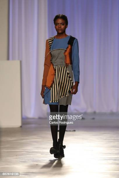 A model walks the runway during the Dino Alves show during Lisboa Fashion Week ModaLisboa day 3 at on March 12 2017 in Lisbon Portugal
