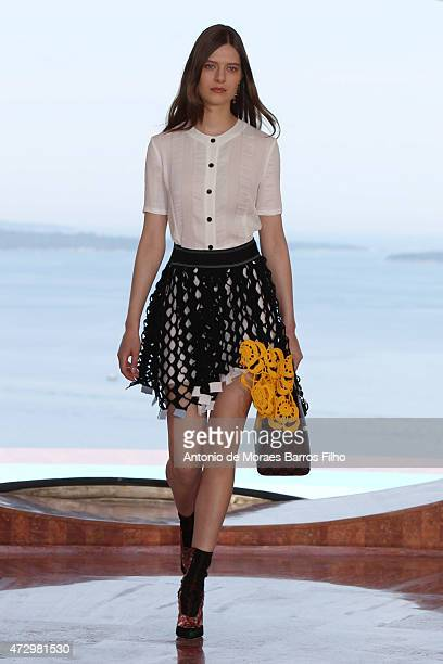 A model walks the runway during the Dior Croisiere 2016 show at 'Palais Bulle Bubble Palace' on May 11 2015 inFrench Riviera France