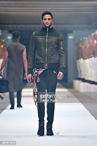 A model walks the runway during the Dirk Bikkembergs as a part of Milan Menswear Fashion Week Fall Winter 2015/2016 on January 20 2015 in Milan Italy