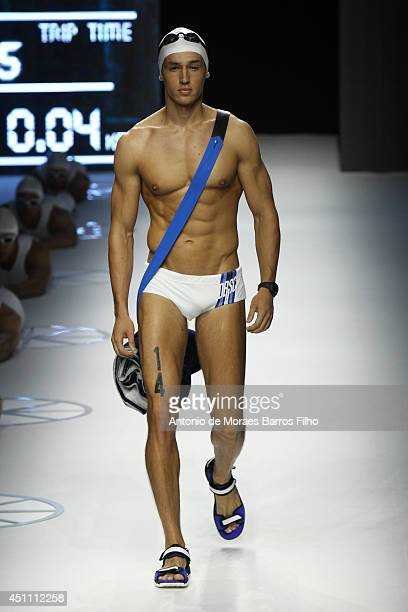A model walks the runway during the Dirk Bikkembergs show as a part of Milan Fashion Week Menswear Spring/Summer 2015 on June 23 2014 in Milan Italy