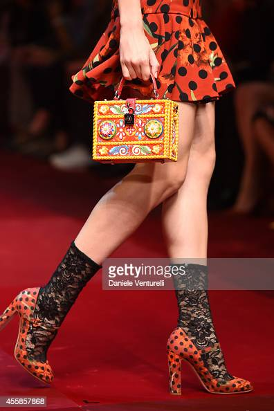 A model walks the runway during the Dolce Gabbana Show as part of Milan Fashion Week Womenswear Spring/Summer 2015on September 21 2014 in Milan Italy