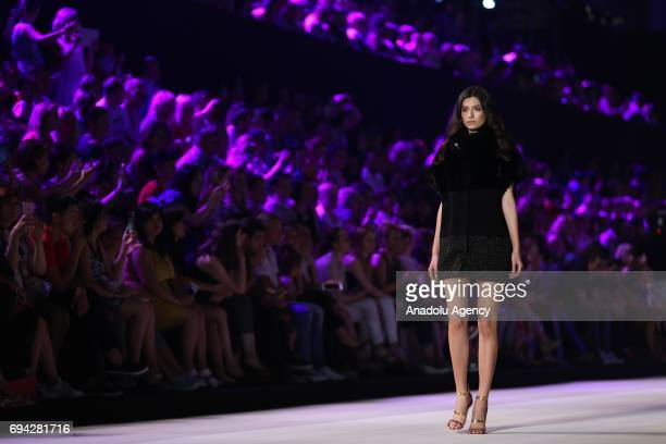 A model walks the runway during the Dosso Dossi Fashion Show in Antalya Turkey on June 09 2017